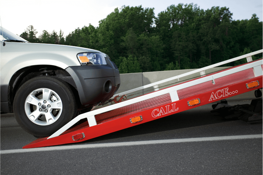 SUV being towed on flatbed