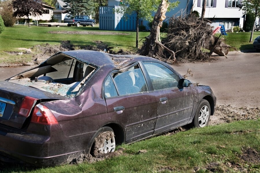 Car Damaged by Tornado Stuck on Side of the Road